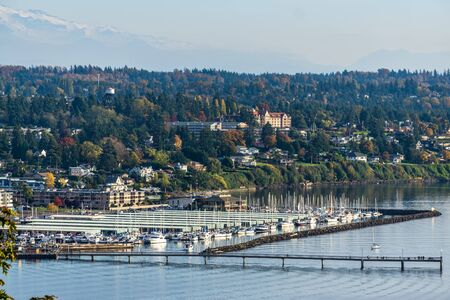 A view of the waterfron and marina in Des Moines, Washington. 写真素材
