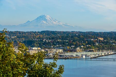 A view of Mount Rainier with Des Moinese, Washington below.
