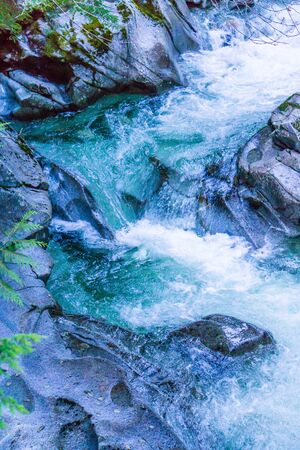Whitewater near rocks in Denny Creek in Washington State.