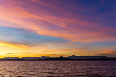 Many colors fill the sky as the sun set over the Puget Sound. 版權商用圖片