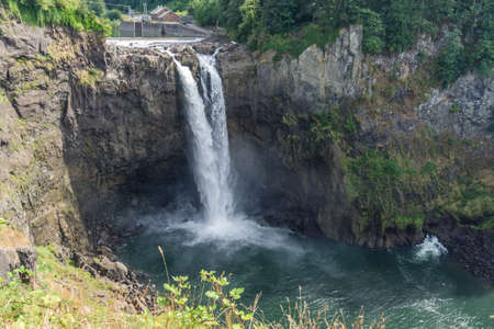 A view of cascading water at Snoqualmie Falls in Washington State.