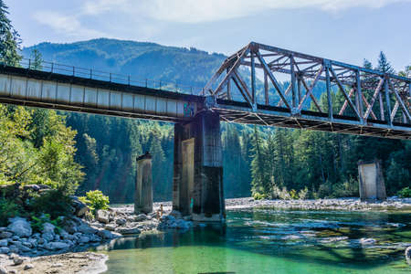 A train trestle spans the Skykomish River in Washington State.