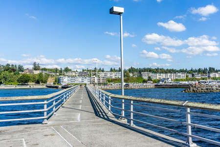 Looking back toward shore on the pier in Des Moinese, Washington.