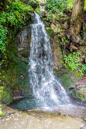 A waterfall flows among large rocks in Tumwater, Washington.