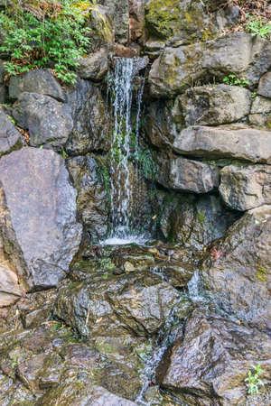 A waterfall flows among large rocks in Tumwater, Washington. Stock fotó