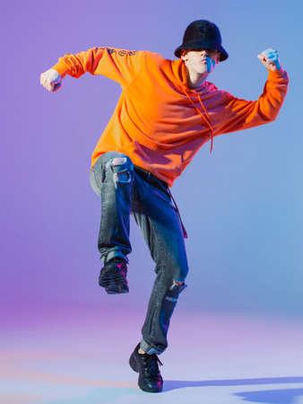 Boy dancing contemporary dance in studio. Breakdancing.