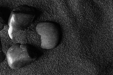 Black stone on a black sand dunes background. Black design.