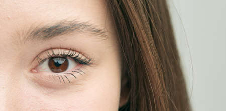 Beautiful eye, close-up of a Caucasian girl who smiles sweetly.