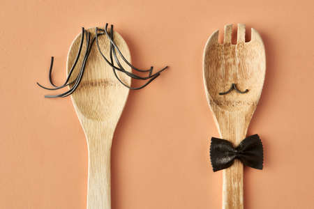 Cartoon family made up of farfalle pasta and wooden spoon, conceptual photography for food blog or ad. High quality photo Stock fotó
