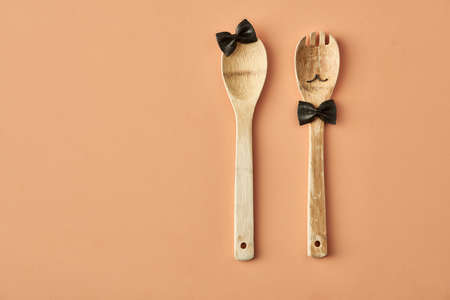 Cartoon girl and man made up of farfalle pasta and wooden spoon, conceptual photography for food blog or ad
