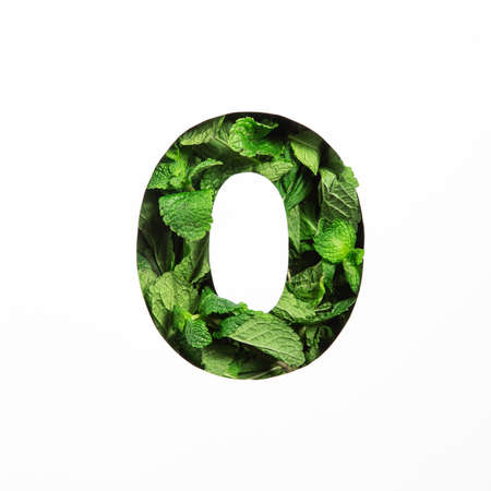 Green mint number zero made of natural leafs and paper cut null shape isolated on white. Typeface from leaves