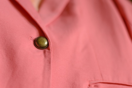 Copper button on the pink girl suit Stock Photo