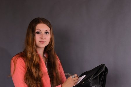 celphone: Young successful businesswoman wearing an office clothes writting  Stock Photo