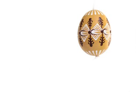 A decorated Easter egg with ribbon on the white background  Stock Photo