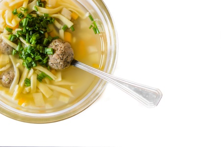 bouillon: Tasty bouillon with liver dumplings on the white background. Stock Photo