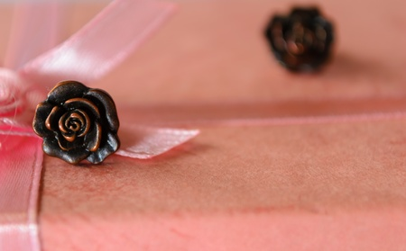 Earing in the shape of the rose on the top of the ping box