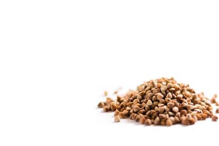 Pile of buckwheat grains on white bacground