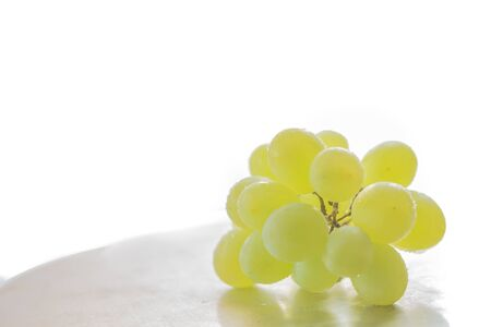 Delicious white grape on the white background