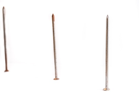 Three nails with rust on the white background