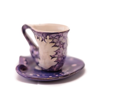 Purple porcelain old cup with dish on white background