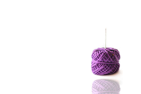 Purple spool with a green measure tape  and needle on the white background  Stock Photo