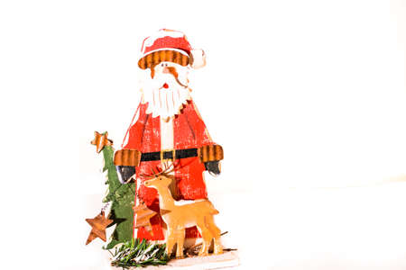Toy of santa clause with tree on white background  Stock Photo