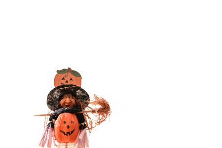 Scary halloween withc with pupkin on white background  Stock Photo