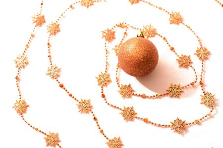 Gold Christmas ball with christmas chain on white background  photo