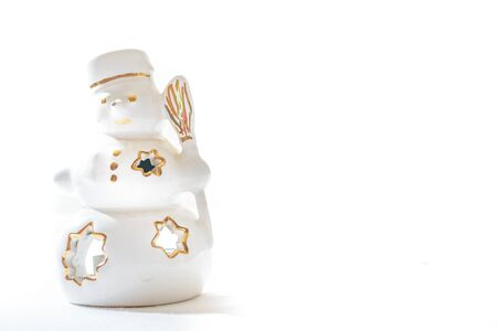 Beautiful ceramics snowman on white background  photo