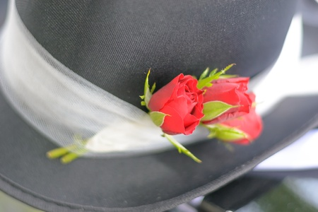 chimney pot: Detail of black wedding top hat with red rose
