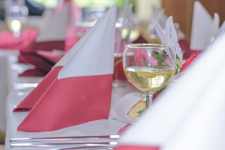 Beautiful red style wedding table with wine and napkins and decoration  photo