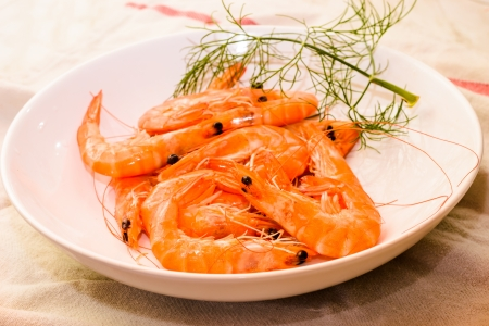 Many raw shrimp in bowl close up-