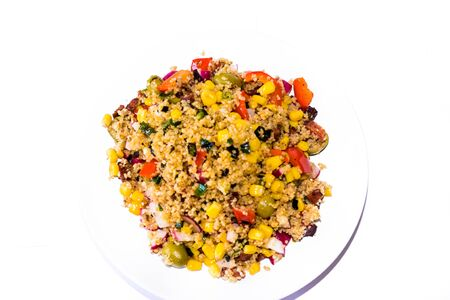 Detail of home made Vegetable cous-cous meal in a white bowl on a white background