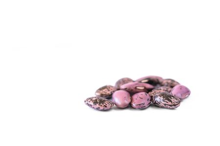 Detail of Many strew motley haricot beans on white background Stock Photo