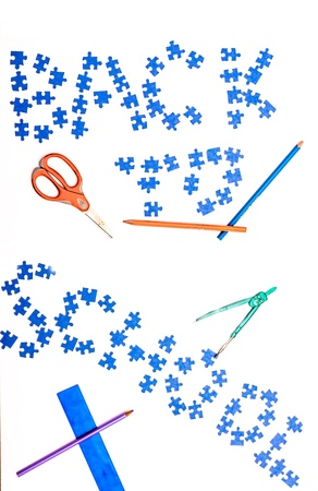 Puzzle sign back to school on white background with scissors, pencil, compasses, spirit pencil  photo