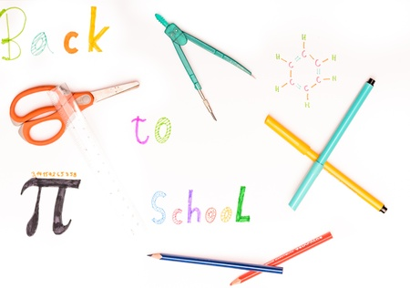 Hand written sign back to school on white background with scissors, pencil, compasses, spirit pencil  photo