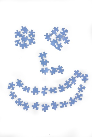 accomplish: Smiley face made by puzzle on white background  Happy  Stock Photo
