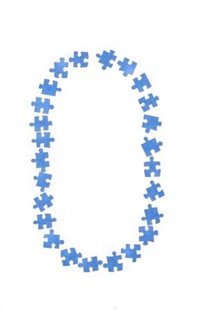 juvenile: Puzzle funny number zero on white background. Stock Photo