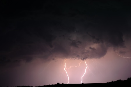 A stream of lightning bolts erupts from a thunder cloud over. Stock Photo - 21528197
