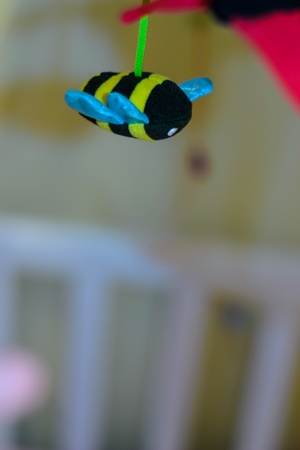 Bee toy in the cradle.