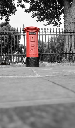British red mailbox in the street in London.