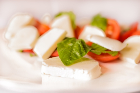 Crative vegetarian food. Bazil tomato and cheese mozzarela. Detail of food.