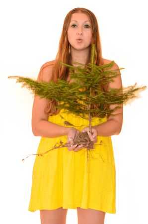 NIce Woman holding a  tree on white bacground  Concept Stock Photo - 21974880