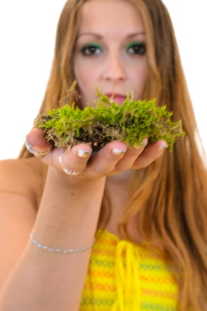 NIce Woman holding a   moss on white bacground  Concept  Stock Photo - 21974881
