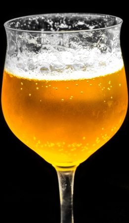 Beer glass against black background. photo