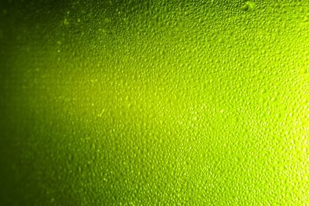 Colorful abstract bacground green. Close up of beer glass. photo