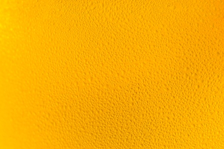 Colorful abstract bacground orange. Close up of beer glass. photo