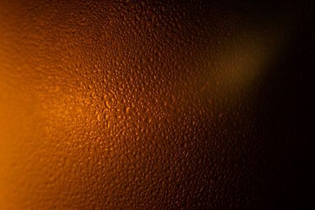 Colorful abstract bacground brown. Close up of beer glass. photo