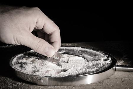 Hand making drug preparing to abuse.