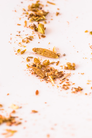 Detail of heap of cumin on the white.